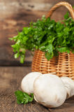Mushrooms and a basket with fresh parsley Stock Photo