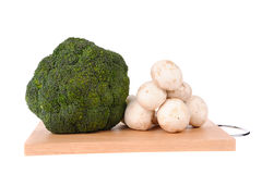 Mushrooms brocolli on the cutting board Stock Photo