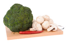Mushrooms brocolli pepper on the cutting board Stock Photography