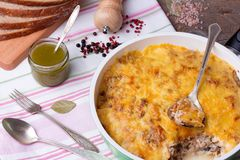 Mushrooms and cabbage casserole in frying pan with bread, pesto, pepper. Casserole with mushrooms and cabbage in frying pan with fresh bread, pesto, pepper and Royalty Free Stock Photography