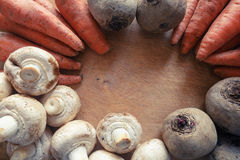 Mushrooms, carrots and beets on a wooden board. In daylight Royalty Free Stock Photography