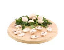 Mushrooms champignon on platter. Royalty Free Stock Photos
