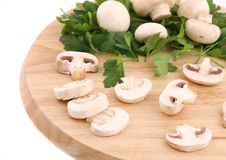 Mushrooms champignon on platter. Stock Photos