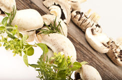 sliced and whole mushrooms on wood Stock Photo