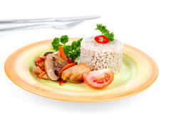 Mushrooms with chicken with pearl barley Stock Photography
