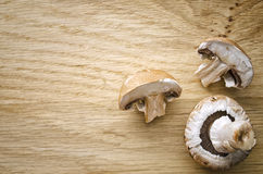 Mushrooms on Chopping Board. Flat lay shot of three mushrooms Royalty Free Stock Photo