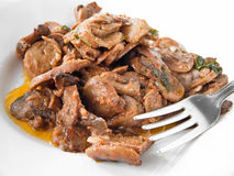 Mushrooms cooked with olive oil and tomato sauce. Stock Images