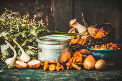 Mushrooms cooking preparation on rustic kitchen table Royalty Free Stock Image