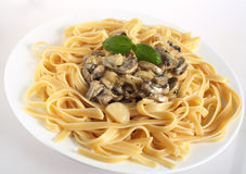 Mushrooms in cream on fettuccini Royalty Free Stock Images