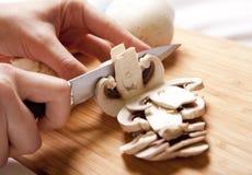 Mushrooms cutting Stock Photos