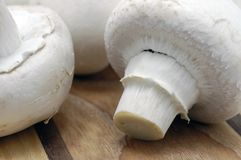 Mushrooms on cutting board Royalty Free Stock Photos