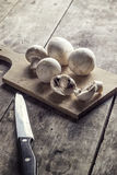 Mushrooms on the Cutting Board Royalty Free Stock Images
