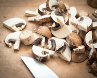 Mushrooms on a cutting board Royalty Free Stock Photos