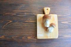 Mushrooms on a cutting board Stock Photos