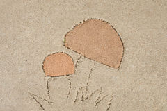 Mushrooms drawing in sand Royalty Free Stock Photography