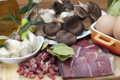 Mushrooms, eggs, ham and olive oil to cook. Royalty Free Stock Images