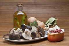 Mushrooms, eggs, ham and olive oil to cook. Royalty Free Stock Photos