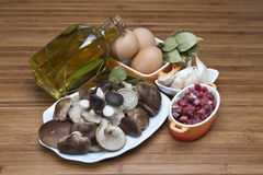 Mushrooms, eggs, ham and olive oil to cook. Stock Photography