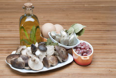 Mushrooms, eggs, ham and olive oil to cook. Stock Image