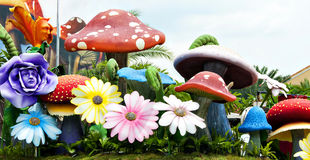Mushrooms and flowers Stock Image