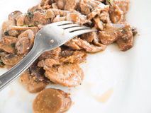 Mushrooms with fork on white dish. Stock Photography