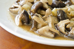 Mushrooms fried. With black pepper Stock Images
