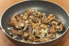 Mushrooms fried with onions Stock Photo