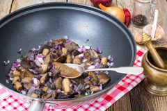 Mushrooms fried with red onion in frying pan Royalty Free Stock Photo