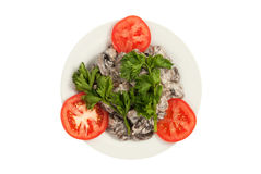 Mushrooms, fried with sour cream on a white plate Royalty Free Stock Photo