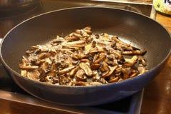 Mushrooms on the frying pan royalty free stock photos