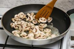 Mushrooms in frying pan Stock Photo