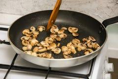 Mushrooms in frying pan Stock Image
