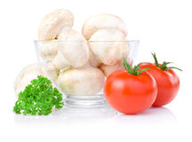 Mushrooms in Glass bowl, two tomatoes and parsley Royalty Free Stock Photography