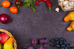 Mushrooms, grape, plums, onion, tomatoes, chilli peppers, glass of red wine, apples and pears in basket. View from above; top stud Royalty Free Stock Photo