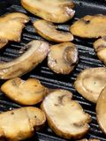 Mushrooms on grill Royalty Free Stock Photography