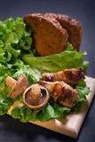 Mushrooms and grilled meat Stock Image