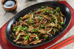 Mushrooms. Grilled on pan with soy sauce stock photos