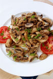 mushrooms on half a bun with tomato Stock Photo