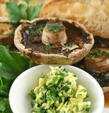 Mushrooms And Herbed Butter. Large field mushrooms with toast and herbed butter Stock Images