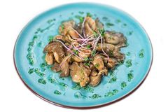 Mushrooms with herbs on a blue plate Royalty Free Stock Images