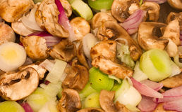 Mushrooms, Leeks and red onions frying in a pan Royalty Free Stock Image