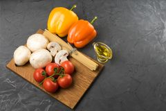 Mushrooms mushrooms, lettuce, tomatoes and spaghetti on stone table. Mushrooms mushrooms, lettuce, tomatoes and spaghetti on table Royalty Free Stock Photography