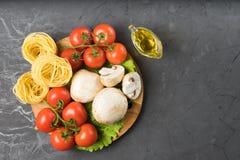 Mushrooms mushrooms, lettuce, tomatoes and spaghetti on stone table. Mushrooms mushrooms, lettuce, tomatoes and spaghetti on table Stock Image