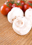 Mushrooms and little red tomatos Royalty Free Stock Photos