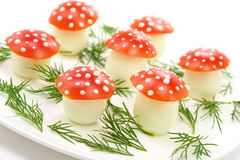 Mushrooms made of eggs and  tomatos. On the white plate Stock Photos