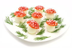 Mushrooms made of eggs and  tomatos. On the white plate Royalty Free Stock Photography