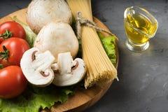 Mushrooms mushrooms, lettuce, tomatoes and spaghetti on stone table. Mushrooms mushrooms, lettuce, tomatoes and spaghetti on table Stock Images