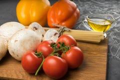 Mushrooms mushrooms, lettuce, tomatoes and spaghetti on stone table. Mushrooms mushrooms, lettuce, tomatoes and spaghetti on table Stock Photography