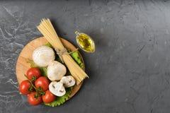 Mushrooms mushrooms, lettuce, tomatoes and spaghetti on stone table. Top view. Mushrooms mushrooms, lettuce, tomatoes and spaghetti on table Stock Photos
