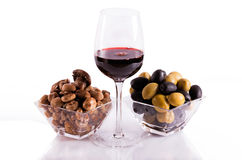 Mushrooms and olives with a glass of wine Stock Photos
